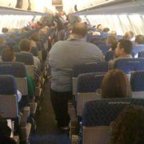 Discussie over zware mensen in het vliegtuig